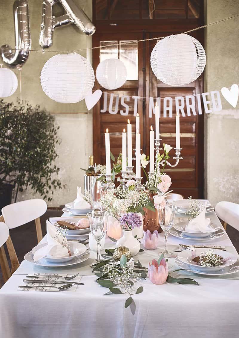 Hochzeitstafel selbst dekorieren<