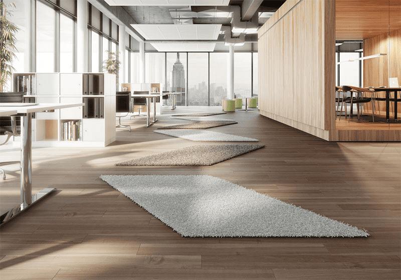 Im Büro wirken ungewöhnliche Teppichformen gut